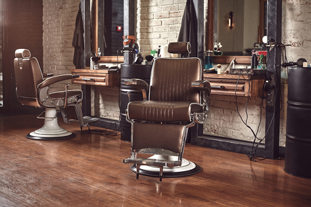 Foto de Barbershop armchair. Modern hairdresser and hair salon, barber shop for men. - Imagen libre de derechos