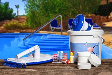 Photo pour Equipment with chemical cleaning products and tools for the maintenance of the swimming pool. - image libre de droit