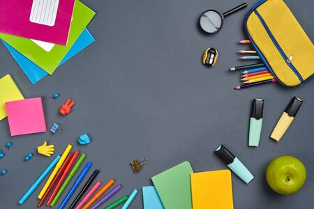 Photo pour Flat lay photo of workspace desk with school accessories or office supplies on gray background. - image libre de droit