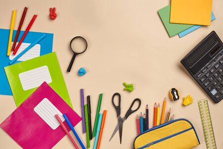 Photo pour Flat lay photo of workspace desk with school accessories or office supplies on pink background. - image libre de droit