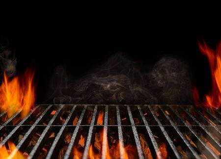 Photo pour Hot empty portable barbecue BBQ grill with flaming fire and ember charcoal on black background. Waiting for the placement of your food. Close up - image libre de droit