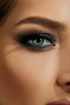 Photo for Face of lady with luxury makeup. Gray eyeshadow, long eyelashes, matte beige lips, brown eyebrows. Professional maquillage. Close up - Royalty Free Image