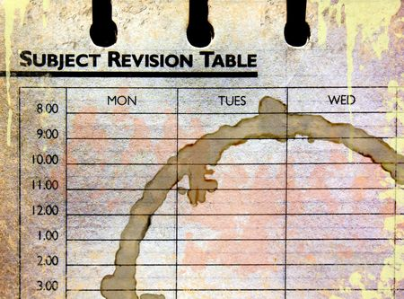 Subject revision table in grunge , which has been neglected and left empty - with complimentary coffee ring stain!