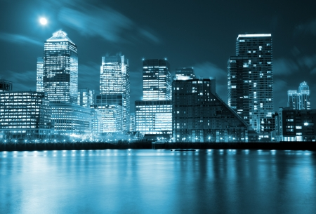 Photo for Full moon over London skyscrapers - Royalty Free Image