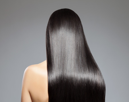Back view of a woman with long straight hairの写真素材