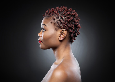 Photo for Black beauty with short spiky red hair - Royalty Free Image