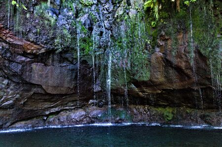 Photo for A natural source on the rock in a cenote cave (Madeira Island, Portugal) - Royalty Free Image
