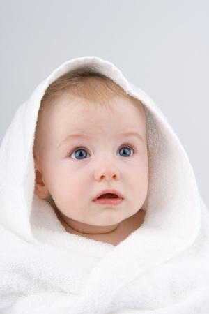 Foto de Infant swaddle towel with wonderstruck look,on white background. - Imagen libre de derechos