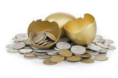 Broken gold egg and old money,on white background.