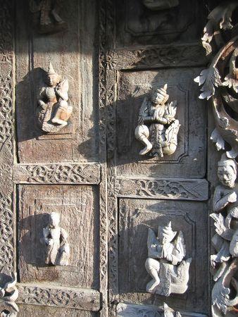 Temple door with four nats - Mandalay - Myanmar.