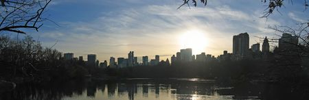 Sunset on the city from central park above the lake - New York.