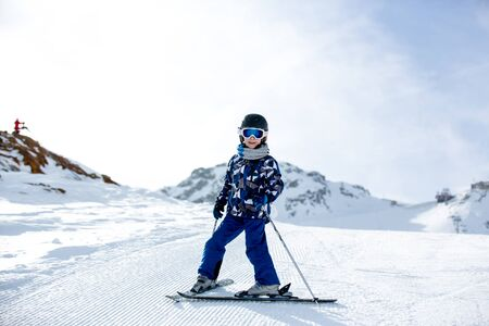 Photo for Happy people, children and adults, skiing on a sunny day in Tyrol mountains. Kids having fun while skiing - Royalty Free Image