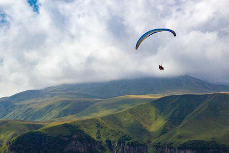 Photo for Paragliding in Gudauri Recreational Area in the Greater Caucasus mountains in Georgia - Royalty Free Image