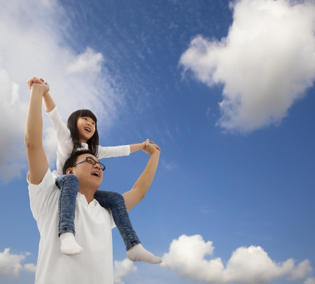 Asian father and daughterunder cloudfield