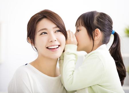 Photo pour mother and daughter whispering gossip - image libre de droit
