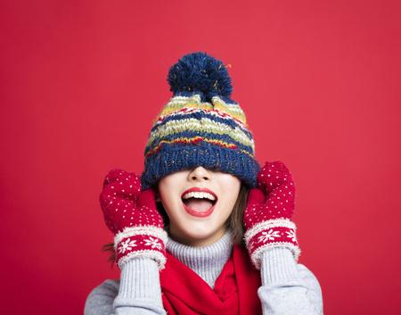 Photo pour Happy Young Beautiful Woman in winter clothes - image libre de droit