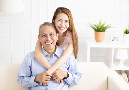 Photo for happy asian daughter holding father on sofa - Royalty Free Image