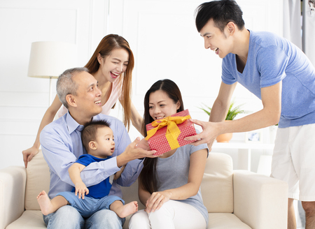 Photo for happy family celebrating and giving gift to father - Royalty Free Image