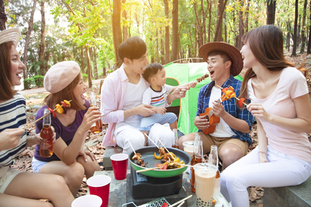 Photo for happy young friends group enjoying picnic party and camping - Royalty Free Image