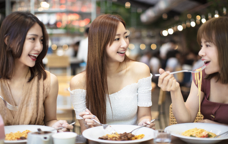 Photo for Happy friends having dinner  in  restaurant - Royalty Free Image
