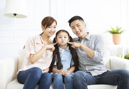 Photo pour Happy parents and child having fun together - image libre de droit