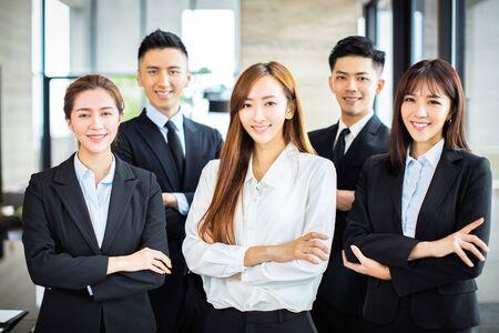 Foto de confident asian business team stands in office - Imagen libre de derechos