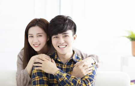 Photo pour Cheerful young couple at home in the morning - image libre de droit