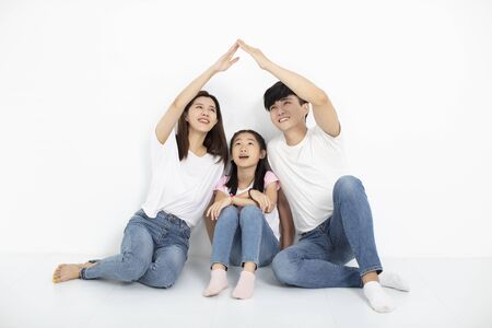 Photo for happy young family sitting on floor with home concept - Royalty Free Image