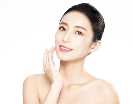 Photo pour Beautiful face of young woman with clean fresh skin - image libre de droit