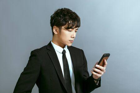 Foto de Handsome young businessman using mobile phone - Imagen libre de derechos