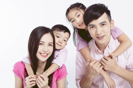 Photo for Young parents piggybacking their two kids - Royalty Free Image