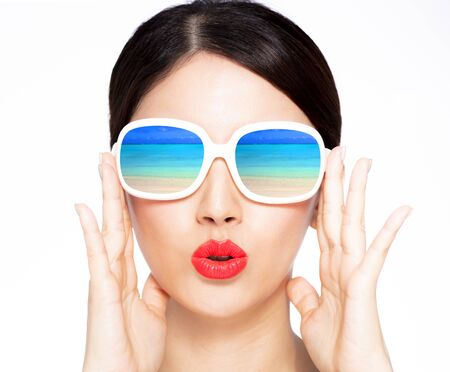 Photo for closeup young beauty in sunglasses with beach reflection - Royalty Free Image