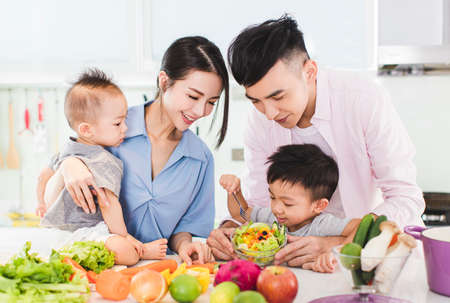 Photo for happy family eating salad in kitchen - Royalty Free Image
