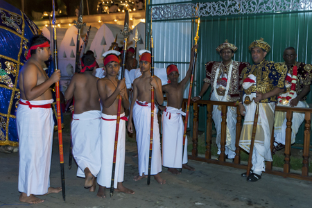Temple Priests and their attendants prior to the start of the Esala Perahera in Kandy. Sri Lanka. The Esala Perahera runs every year in late July or early August for ten days, ending on the Nikini poya full moon and is held to honour the Sacred Tooth Reli