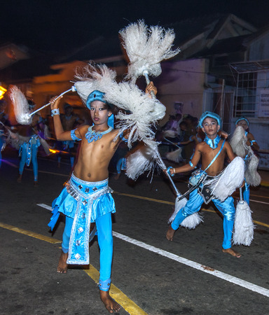 Chamara Dancers perform along the streets of Kandy in Sri Lanka during the Esala Perahera. Chamara Dancers perform a dance whereby the yak tails they hold symbolically fan the Sacred Tooth Relic. The Esala Perahera is held to honour the Sacred Tooth Relic