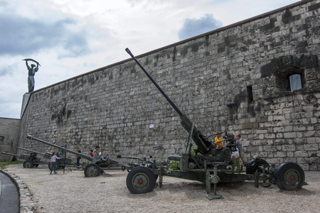 Children inspect military artillery set up at the Citadel (Fortress) on Gellert Hill in Budapest in Hungary.