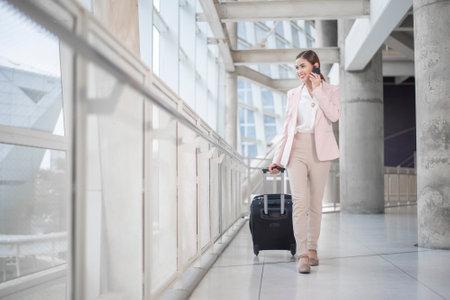 Photo pour Beautiful business woman is walking in Airport , Business travel concept - image libre de droit