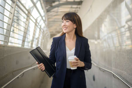 Photo for Portrait of beautiful young asian business woman is working in modern city - Royalty Free Image