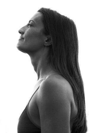 Foto de Her stunning profile is captured against a white background - Imagen libre de derechos