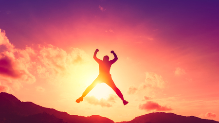 Photo pour Happy man jumping at top of mountain with sunset sky abstract background. Freedom feel good and summer vacation concept. Vintage tone filter effect color style. - image libre de droit