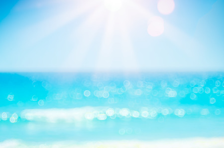 Photo pour Summer vacation outdoor and travel holiday adventure concept.Copy space blur tropical beach with bokeh sun light wave on blue sky and white cloud abstract background. Vintage tone filter effect color. - image libre de droit