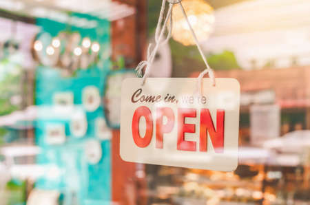 Photo for Open sign broad hanging on door front of cafe. Business service and food concept. Vintage tone filter effect color style. - Royalty Free Image