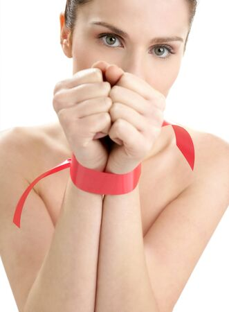 Beauty cosmetic portrait of funny tied hands woman with red tape