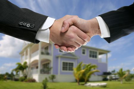 Businessman teamwork real state house partners shaking hands handshake