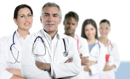 expertise gray hair doctor multiracial nurse team row over white