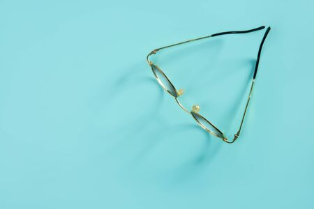 doctor glasses with soft shadow over green desk background