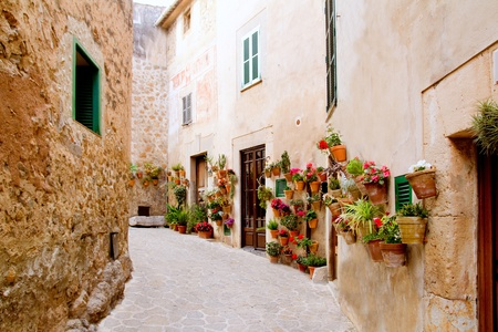 Majorca Valldemossa typical village with flower pots in facades at Spain