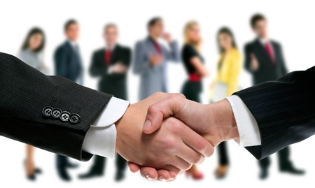 business people handshake with company team in backgroundの写真素材