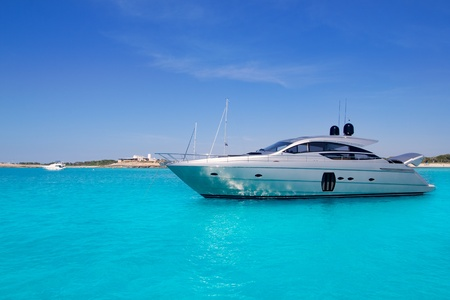 Luxury yatch in turquoise beach of Formentera Illetes