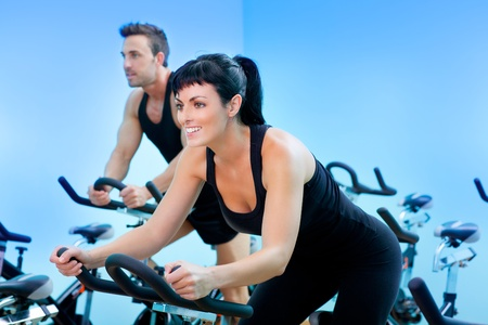 Stationary spinning bicycles fitness girl in a gym sport club
